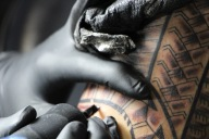 Mayo Landicho of Birthmark Tattoos in East Vancouver puts the finishing touches on his client's traditional half-sleeve.